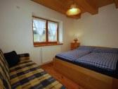 Veľký apartmán - modrá spálňa s kúpeľňou
