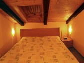 manželská posteľ v apartmáne